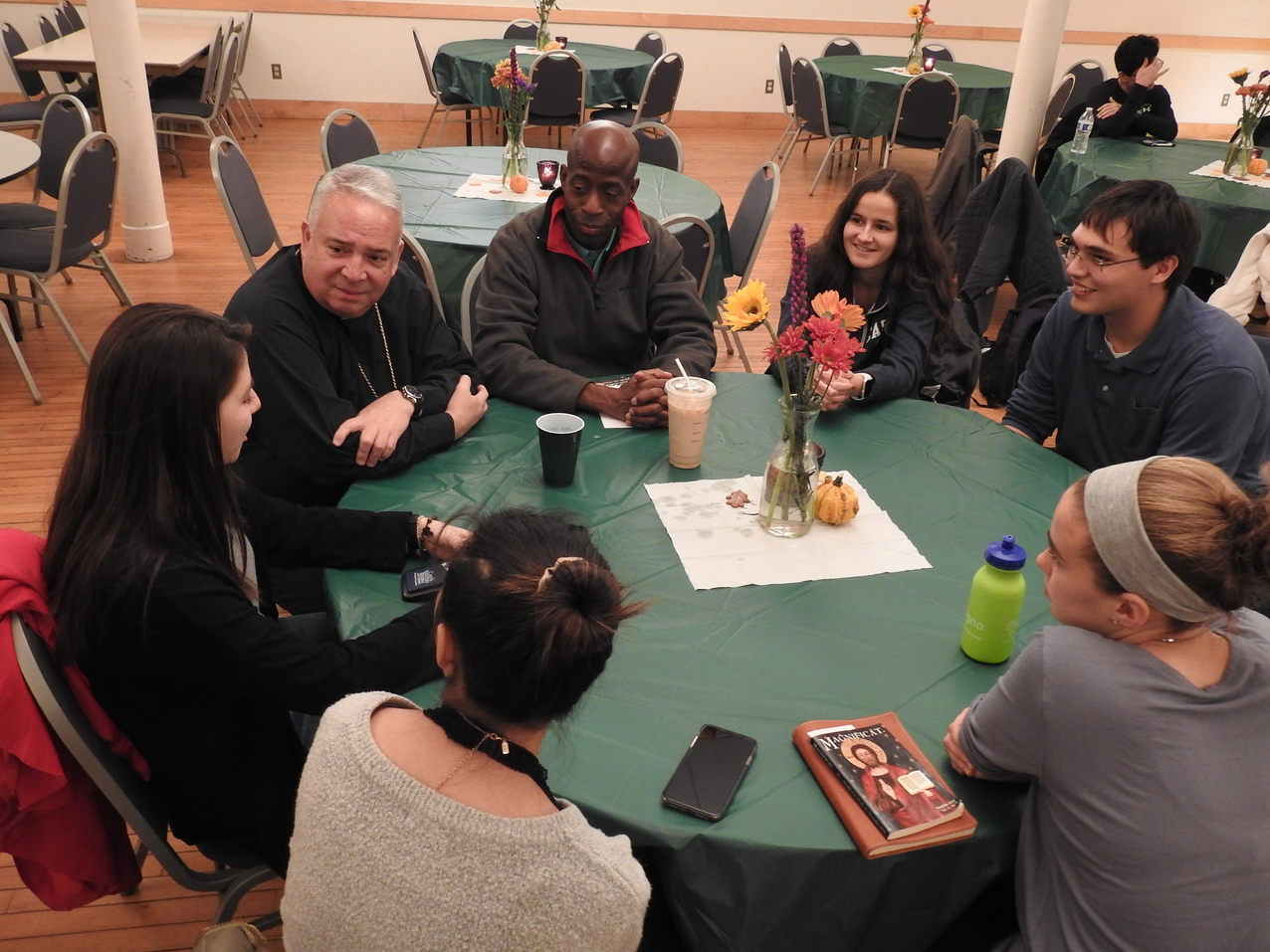 Prayer, food, conversation highlight bishop's visit with Case Catholic Campus Ministry