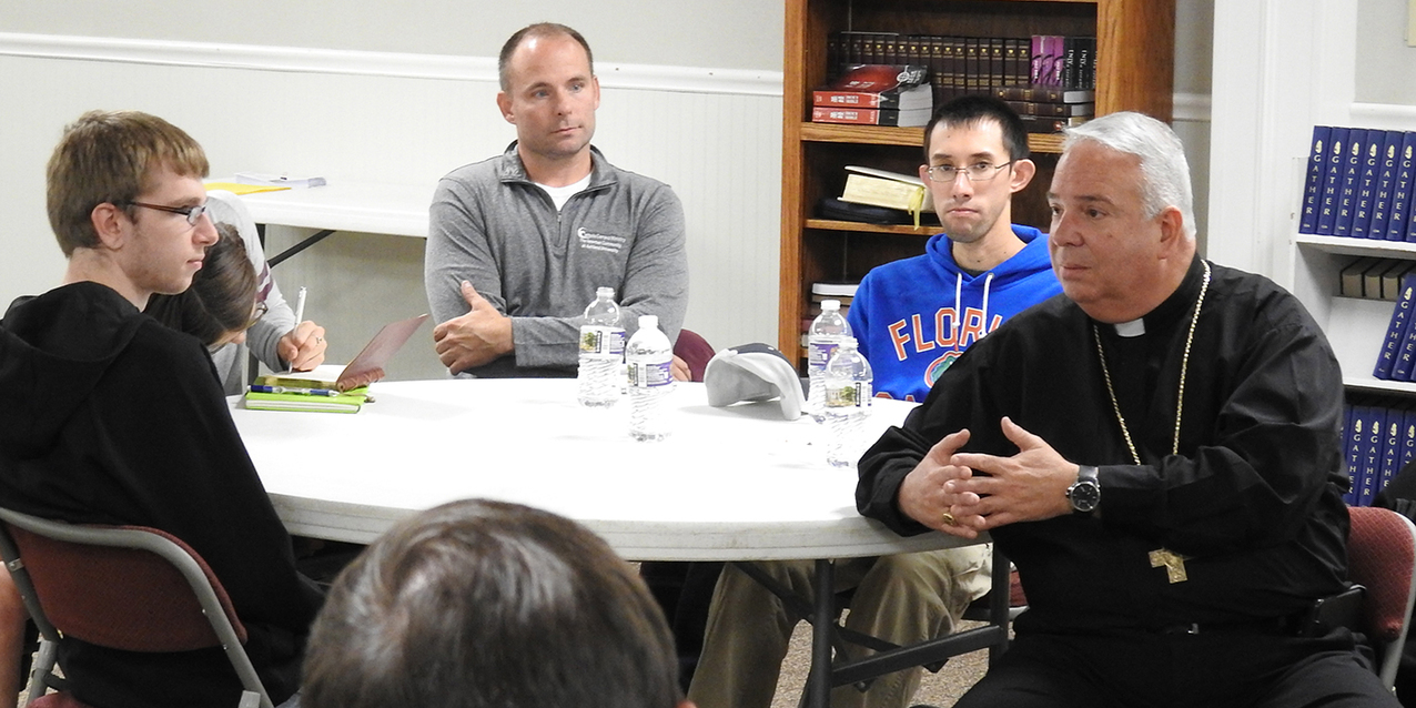 Newman Community at Ashland University hosts Bishop Perez for dinner, discussion