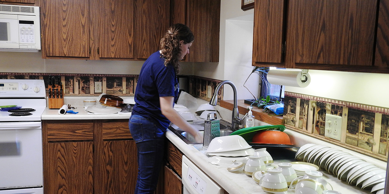 Volunteers roll up their sleeves to prepare housing for The Culture Project missionaries